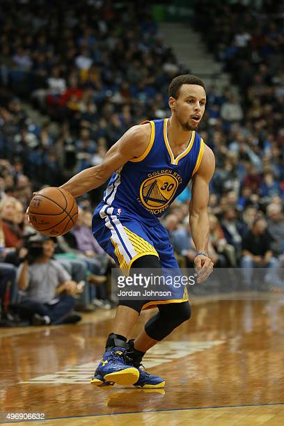 Stephen Curry of the Golden State Warriors handles the ball against the Minnesota Timberwolves on November 12 2015 at Target Center in Minneapolis...