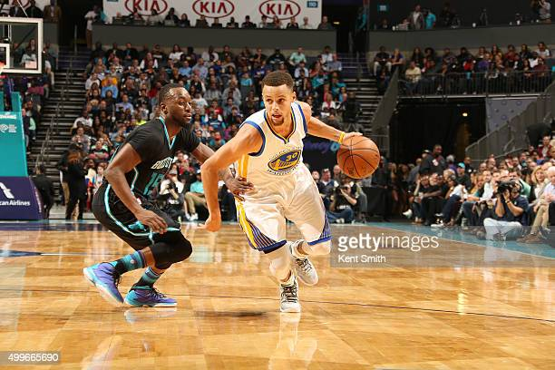Stephen Curry of the Golden State Warriors handles the ball against Kemba Walker of the Charlotte Hornets on December 2 2015 at Time Warner Cable...