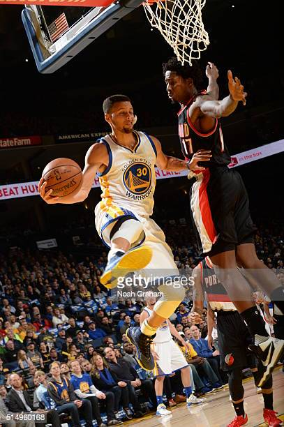 Stephen Curry of the Golden State Warriors handles the ball against the Portland Trail Blazers on March 11 2016 at Oracle Arena in Oakland California...