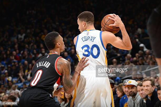 Stephen Curry of the Golden State Warriors handles the ball against Damian Lillard of the Portland Trail Blazers on March 11 2016 at Oracle Arena in...