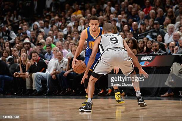 Stephen Curry of the Golden State Warriors handles the ball against Tony Parker of the San Antonio Spurs on March 19 2016 at the ATT Center in San...