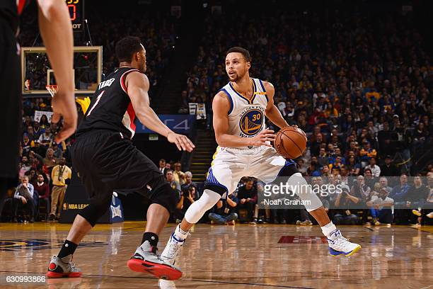 Stephen Curry of the Golden State Warriors handles the ball against the Portland Trail Blazers during the game on January 4 2017 at ORACLE Arena in...