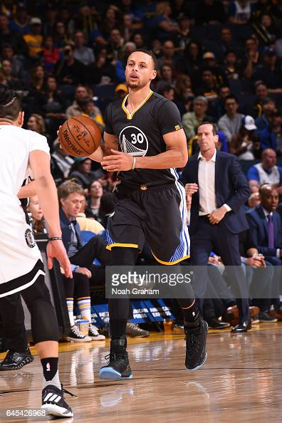 Stephen Curry of the Golden State Warriors handles the ball against the Brooklyn Nets on February 25 2017 at ORACLE Arena in Oakland California NOTE...