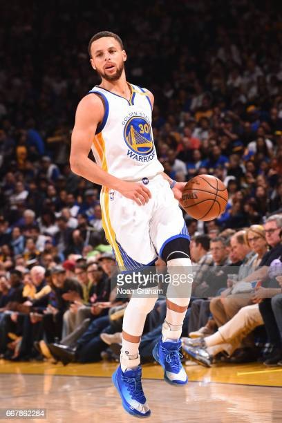 Stephen Curry of the Golden State Warriors handles the ball against the Los Angeles Lakers on April 12 2017 at ORACLE Arena in Oakland California...