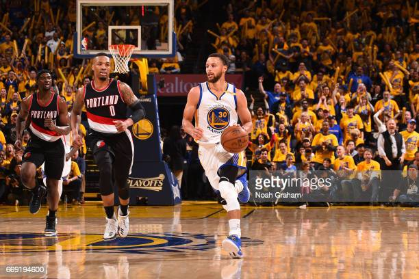 Stephen Curry of the Golden State Warriors handles the ball against the Portland Trail Blazers during the Western Conference Quarterfinals of the...