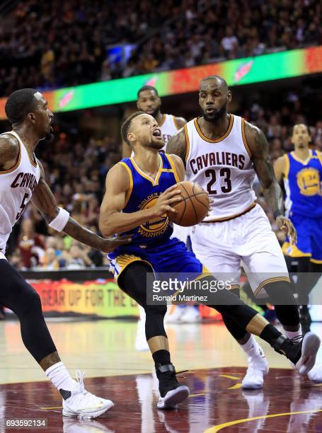 Stephen Curry of the Golden State Warriors handles the ball against LeBron James of the Cleveland Cavaliers in the second quarter in Game 3 of the...