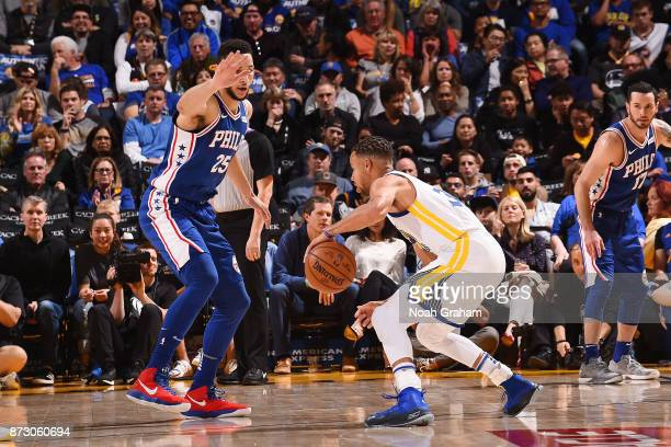 Stephen Curry of the Golden State Warriors handles the ball against Ben Simmons of the Philadelphia 76ers on November 11 2017 at ORACLE Arena in...