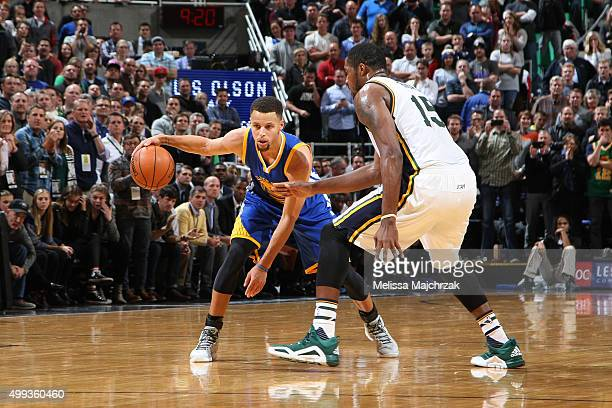 Stephen Curry of the Golden State Warriors handles the ball during the game against the Utah Jazz on November 30 2015 at EnergySolutions Arena in...