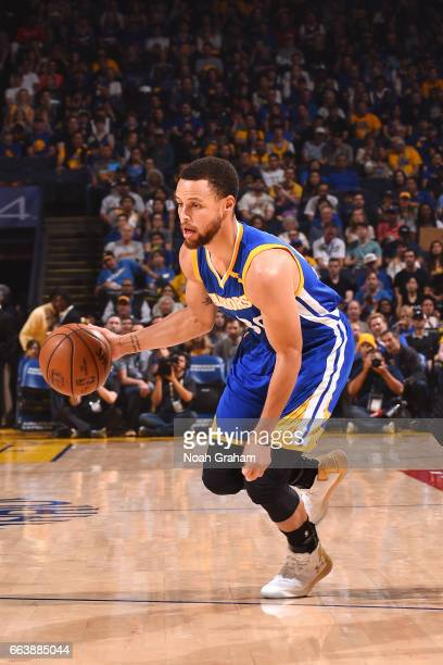 Stephen Curry of the Golden State Warriors handles the ball during the game against the Washington Wizards on April 2 2017 at ORACLE Arena in Oakland...