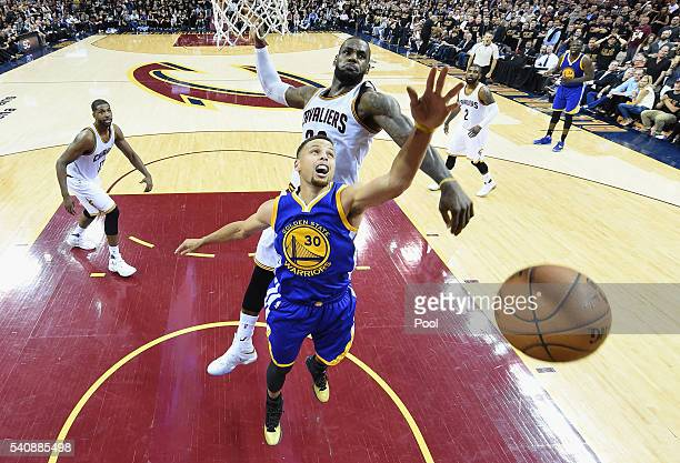 Stephen Curry of the Golden State Warriors has his shot blocked by LeBron James of the Cleveland Cavaliers during the second half in Game 6 of the...