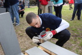 Stephen Curry of the Golden State Warriors helps paint during the NBA Cares AllStar Day of Service 'LEARN' with City Year as part of the 2014 NBA...