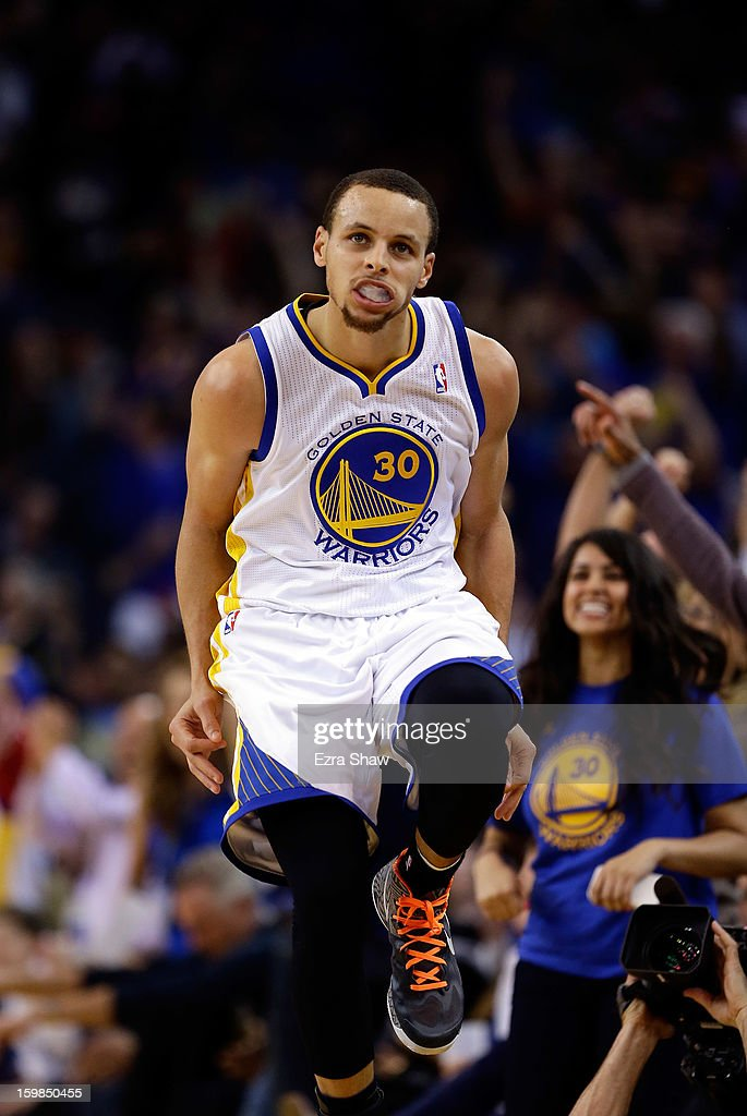 Stephen Curry #30 of the Golden State Warriors high steps back down the court after making a three-point basket against the Los Angeles Clippers at Oracle Arena on January 21, 2013 in Oakland, California.