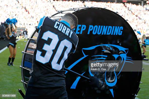Stephen Curry of the Golden State Warriors hits the 'Keep Pounding' drum for the Carolina Panthers prior to Super Bowl 50 against the Denver Broncos...
