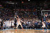 Stephen Curry of the Golden State Warriors hits the winning shot against Andre Roberson of the Oklahoma City Thunder on February 27 2016 at...