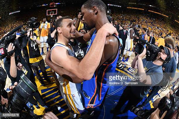 Stephen Curry of the Golden State Warriors hugs Kevin Durant of the Oklahoma City Thunder after Game Seven of the Western Conference Finals during...
