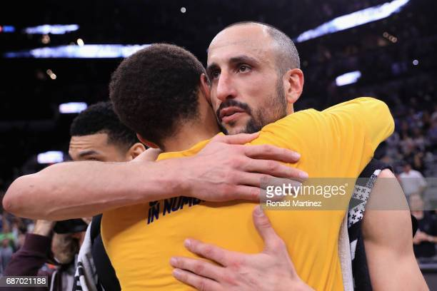 Stephen Curry of the Golden State Warriors hugs Manu Ginobili of the San Antonio Spurs after the Golden State Warriors defeated the San Antonio Spurs...