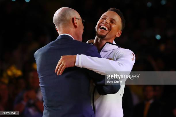 Stephen Curry of the Golden State Warriors hugs NBA Commissioner Adam Silver during their 2017 NBA Championship ring ceremony at ORACLE Arena on...