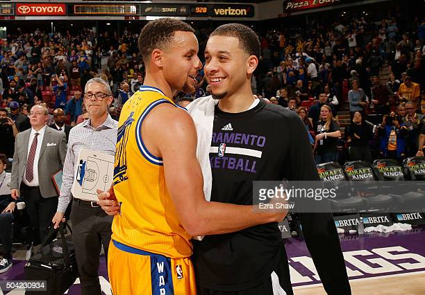 Stephen Curry of the Golden State Warriors hugs Seth Curry of the Sacramento Kings after their game at Sleep Train Arena on January 9 2016 in...