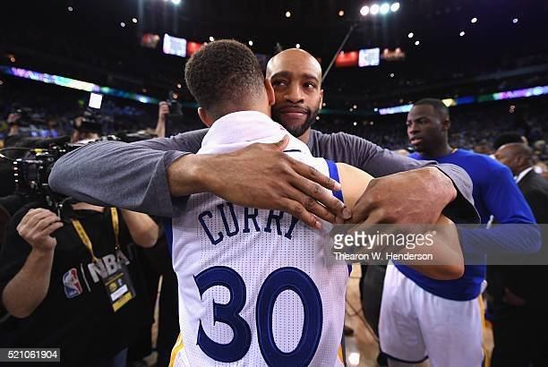 Stephen Curry of the Golden State Warriors hugs Vince Carter of the Memphis Grizzlies after the Warriors defeated the Grizzlies 125104 at ORACLE...