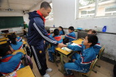 Stephen Curry of the Golden State Warriors interacts with the kids at the NBA Cares Reading and Learning Center as part of 2013 Global Games on...