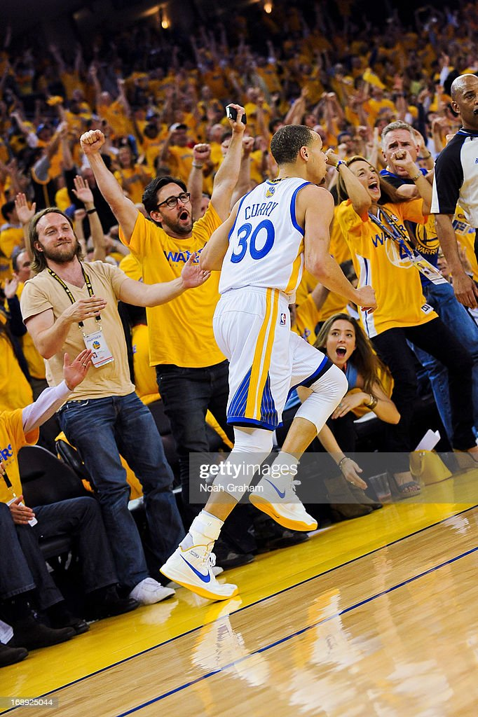 Stephen Curry #30 of the Golden State Warriors is cheered on by fans after making a three-pointer against the San Antonio Spurs in Game Six of the Western Conference Semifinals during the 2013 NBA Playoffs on May 16, 2013 at Oracle Arena in Oakland, California.