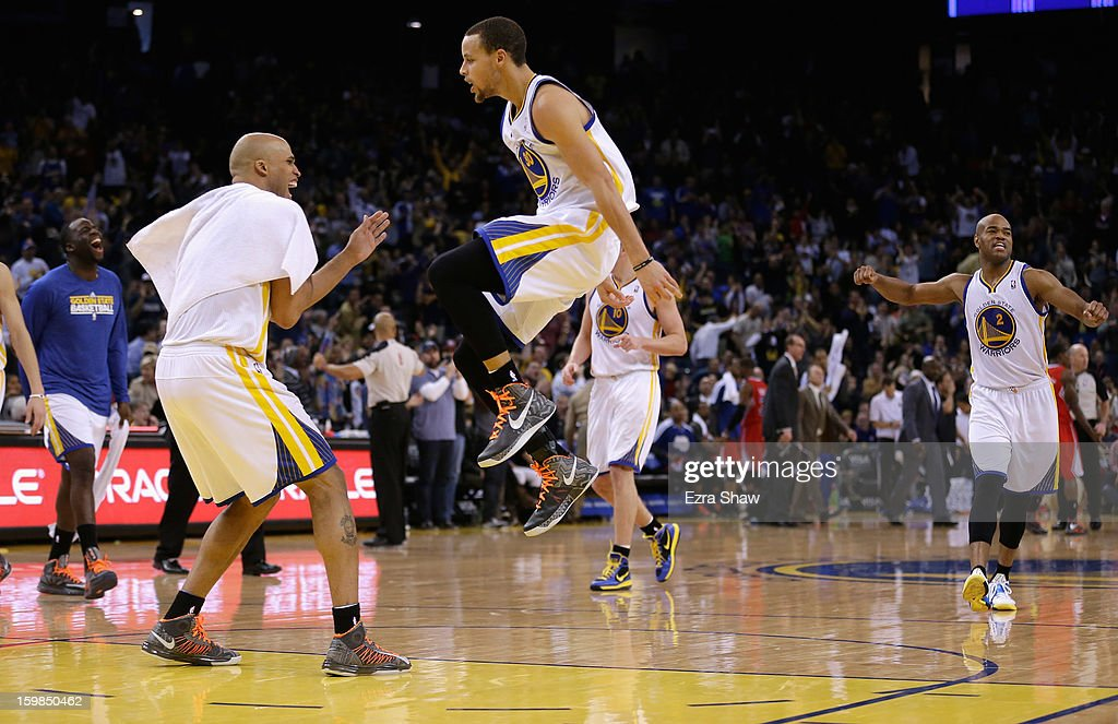 Stephen Curry #30 of the Golden State Warriors is congratulated by Richard Jefferson #44 after making a three-point basket against the Los Angeles Clippers at Oracle Arena on January 21, 2013 in Oakland, California.