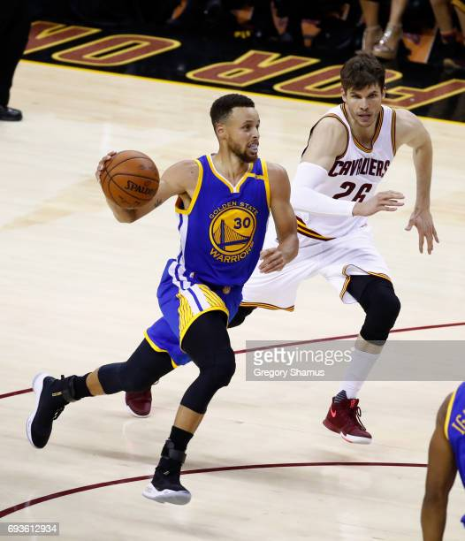 Stephen Curry of the Golden State Warriors is defended by Kyle Korver of the Cleveland Cavaliers in Game 3 of the 2017 NBA Finals at Quicken Loans...