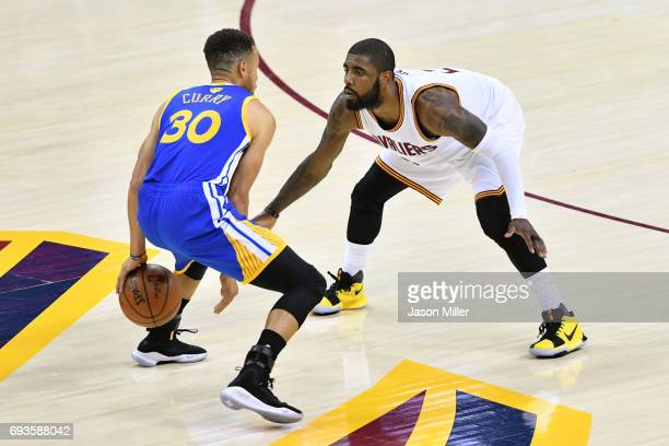 Stephen Curry of the Golden State Warriors is defended by Kyrie Irving of the Cleveland Cavaliers during the first half in Game 3 of the 2017 NBA...