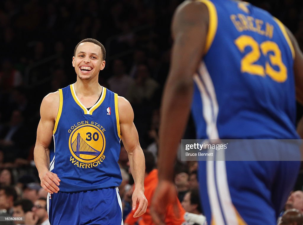 Stephen Curry #30 of the Golden State Warriors is greeted by Draymond Green #23 after breaking the 50 point mark en route to a total of 54 in the game against the New York Knicks at Madison Square Garden on February 27, 2013 in New York City.