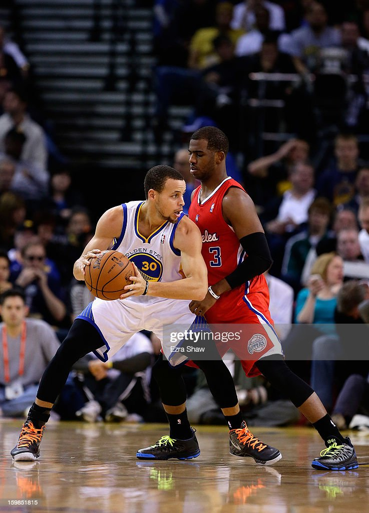 Stephen Curry #30 of the Golden State Warriors is guarded by Chris Paul #3 of the Los Angeles Clippers at Oracle Arena on January 21, 2013 in Oakland, California.