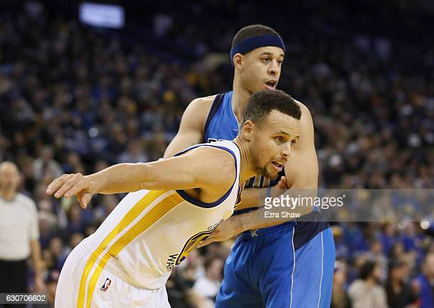 Stephen Curry of the Golden State Warriors is guarded by his brother Seth Curry of the Dallas Mavericks at ORACLE Arena on December 30 2016 in...