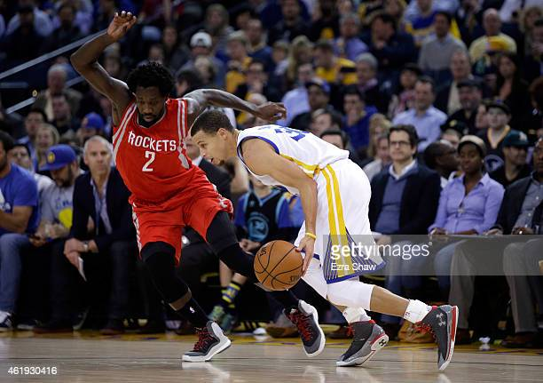 Stephen Curry of the Golden State Warriors is guarded by Patrick Beverley of the Houston Rockets at ORACLE Arena on January 21 2015 in Oakland...