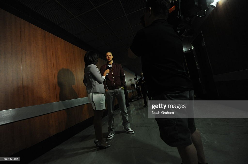 Stephen Curry #30 of the Golden State Warriors is interviewed before the game against the Los Angeles Clippers at STAPLES Center on March 12, 2014 in Los Angeles, California.