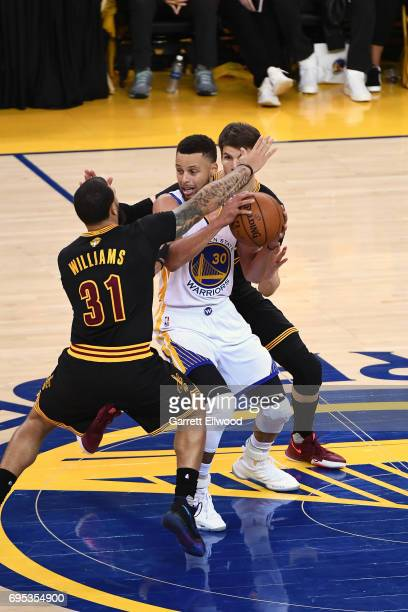 Stephen Curry of the Golden State Warriors is trapped between two defenders of the Cleveland Cavaliers in Game Five of the 2017 NBA Finals on June 12...