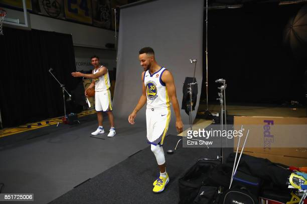 Stephen Curry of the Golden State Warriors jokes with Zaza Pachulia of the Golden State Warriors during the Golden States Warriors media day at...