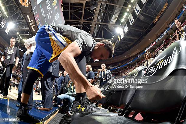 Stephen Curry of the Golden State Warriors laces up his shoes before Game Three of the 2015 NBA Finals at The Quicken Loans Arena on June 9 2015 in...