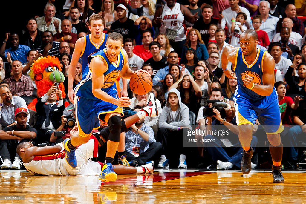 Stephen Curry #30 of the Golden State Warriors leads a fast break against the Miami Heat on December 12, 2012 at American Airlines Arena in Miami, Florida.
