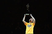 Stephen Curry of the Golden State Warriors lifts up his MVP trophy before their game against the Portland Trail Blazers in Game Five of the Western...