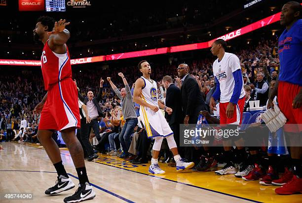 Stephen Curry of the Golden State Warriors look back to the Los Angeles Clippers bench after he made a basket over DeAndre Jordan in the fourth...