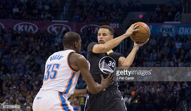 Stephen Curry of the Golden State Warriors looks for a play as Kevin Durant of the Oklahoma City Thunder apples pressure during the first quarter of...