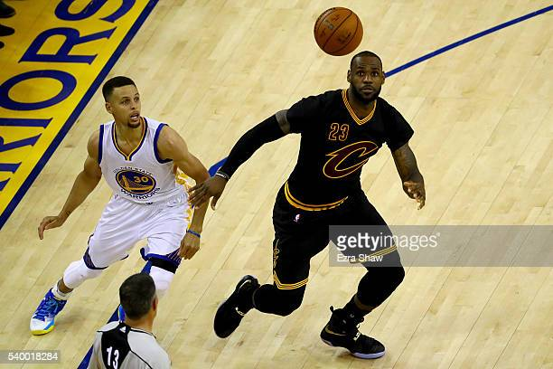 Stephen Curry of the Golden State Warriors looks for the rebound against LeBron James of the Cleveland Cavaliers in Game 5 of the 2016 NBA Finals at...
