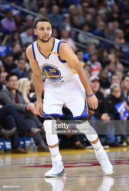 Stephen Curry of the Golden State Warriors looks on against the Sacramento Kings during an NBA basketball game at ORACLE Arena on March 24 2017 in...