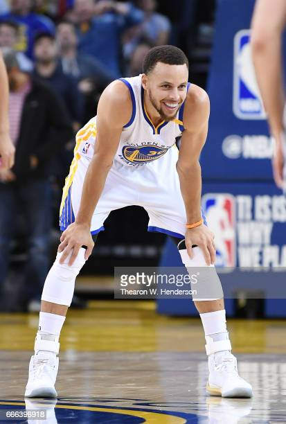 Stephen Curry of the Golden State Warriors looks on against the Minnesota Timberwolves during an NBA basketball game at ORACLE Arena on April 4 2017...