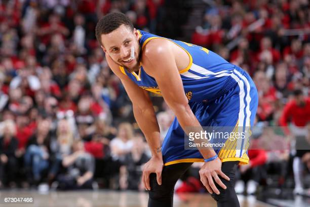 Stephen Curry of the Golden State Warriors looks on during the game against the Portland Trail Blazers during Game Four of the Western Conference...
