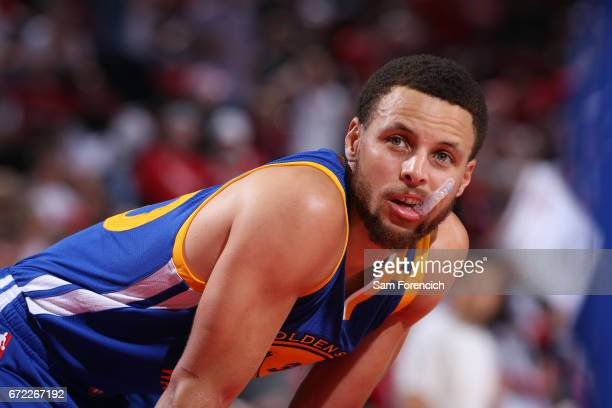 Stephen Curry of the Golden State Warriors looks on in Game Three of the Western Conference Quarterfinals against the Portland Trail Blazers of the...
