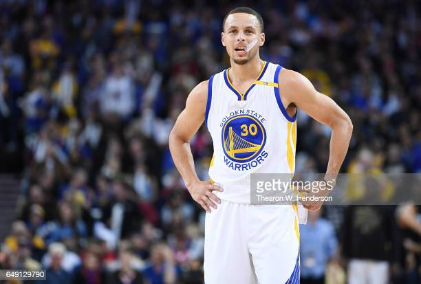 Stephen Curry of the Golden State Warriors looks on while there's a break in the action against the LA Clippers during an NBA basketball game at...