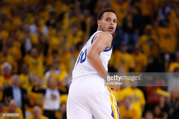 Stephen Curry of the Golden State Warriors looks over his shoulder in the second half while taking on the Houston Rockets during game five of the...