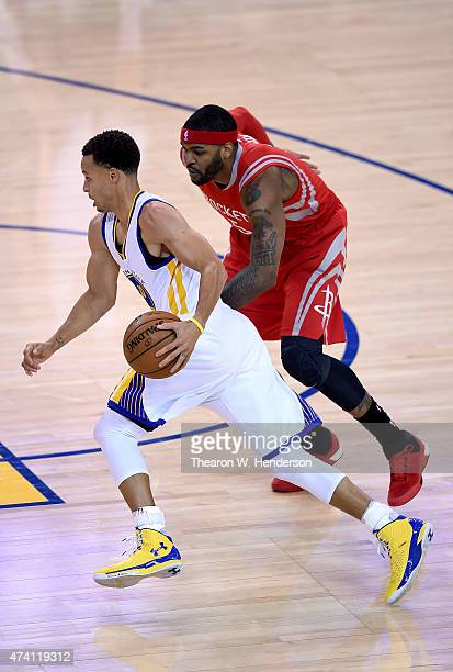 Stephen Curry of the Golden State Warriors looks to dibble past Josh Smith of the Houston Rockets during the first half in Game One of the Western...