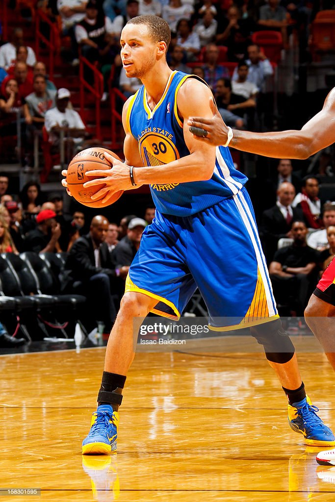 Stephen Curry #30 of the Golden State Warriors looks to pass the ball against the Miami Heat on December 12, 2012 at American Airlines Arena in Miami, Florida.