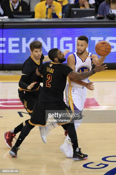 Stephen Curry of the Golden State Warriors looks to pass the ball against Kyrie Irving and Kyle Korver of the Cleveland Cavaliers in Game 5 of the...